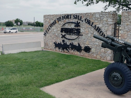In this June 17, 2014, file photo, a vehicle drives by a sign at Scott Gate at Fort Sill, Okla. (Sue Ogrocki/AP)
