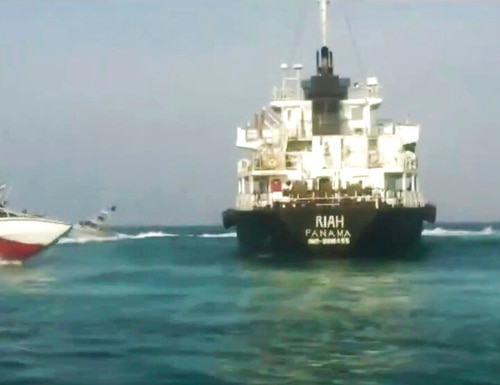 The Panamanian-flagged oil tanker MT Riah surrounded by Iranian Revolutionary Guard vessels. Iran said Thursday that its Revolutionary Guard seized a foreign oil tanker and its crew of 12 for smuggling fuel out of the country. On Friday, Iran claimed that it had seized another tanker, the British-flagged Impero Stena, in the Strait of Hormuz. (Press TV via AP)