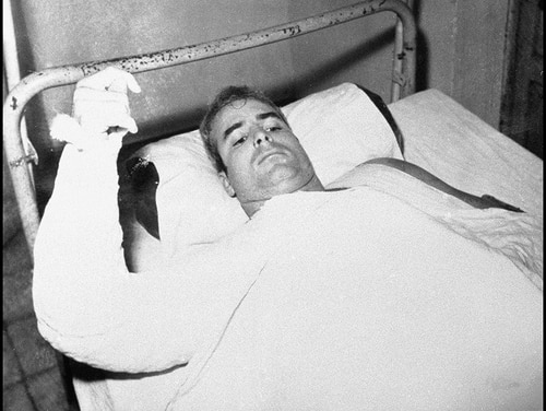 In this undated file photo provided by CBS, U.S. Navy Lt. Cmdr. John S. McCain lies injured in North Vietnam. McCain, the war hero who became the GOP's standard-bearer in the 2008 election, died Saturday, Aug. 25, 2018. He was 81. (CBS via AP)