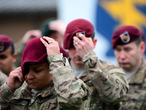 Soldiers assigned to 5th Special Forces Group don berets bearing the new unit flash during a flash changeover ceremony at Fort Campbell, Ky. (Staff Sgt. Kissta DiGregorio/Army)
