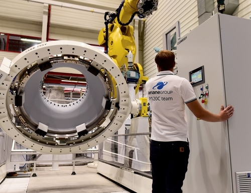 An employee works on a part of a rocket nozzle on an assembly line on July 12, 2018, during the inauguration of the B-Line factory of the aerospace company ArianeGroup, in Le Haillan, southwestern France. - This factory manufactures the nozzles of the P120 solid rocket motor for the future European launcher Ariane 6. (Photo by Nicolas Tucat/AFP via Getty Images)