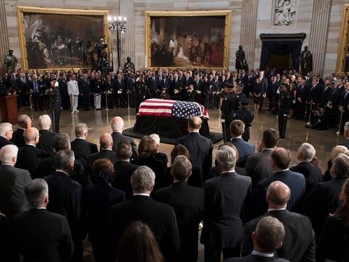 The flag-draped casket of Sen. John McCain, R-Ariz., lies in state in the U.S. Capitol Rotunda on Aug. 31, 2018. (Jim Watson/Pool Photo via AP)