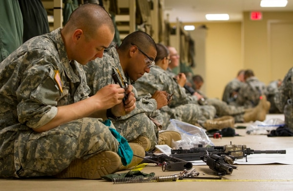 U.S. Army recruits clean their M16s in their company bay during white phase of basic combat training at Fort Jackson, S.C., March 15, 2015. (U.S. Army photo by Sgt. Ken Scar)