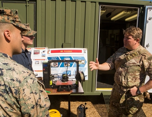 Marines with 2nd Maintenance Battalion, 2nd Marine Logistics Group discuss the capabilities of 3-D printing technology with a British Royal Navy Commando during Exercise Bold Alligator 17 at Camp Lejeune, N.C., Oct. 26, 2017. (Lance Cpl. Abrey D. Liggins/Marine Corps)