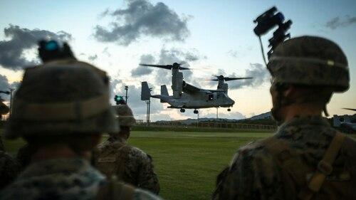 Marines assigned to Bravo Company, 1st Battalion, 3rd Marine Regiment, observe an MV-22 Osprey land aboard Camp Hansen, Okinawa, Japan, Nov. 2, 2017. (Sgt. Aaron S. Patterson/Marine Corps)