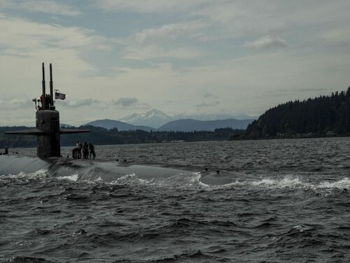 The submarine Bremerton, the longest-serving submarine in Navy history, steams into the Puget Sound Naval Shipyard earlier this year, ending the 37-year-old boat's stint on active duty. (Navy)