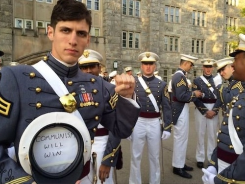 2nd Lt. Spenser Rapone is under investigation after tweeting photos of himself supporting communism while in uniform. (Source: Twitter)
