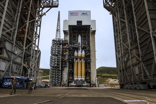 The National Reconnaissance Office Launch-82 vehicle, supported by Delta IV Heavy rockets, stands at Space Launch Complex-6 at Vandenberg Air Force Base, California, April 25. (Staff Sgt. Luke Kitterman/Space Force)