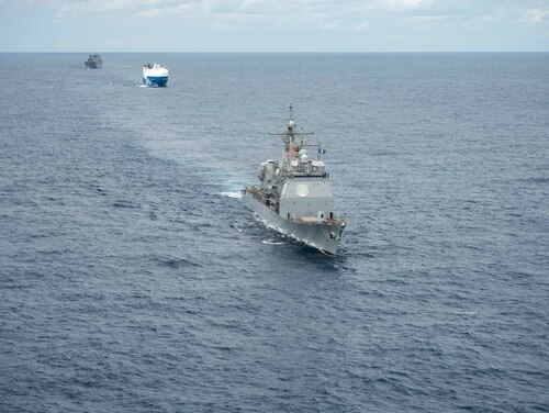 A convoy complied of the Ticonderoga-class guided-missile cruiser Vella Gulf, MV Resolve, center, and USNS Benavidez (T-AKR 306) steam in formation in the Atlantic Ocean on Feb. 28. (MC3 Andrew Waters/Navy)