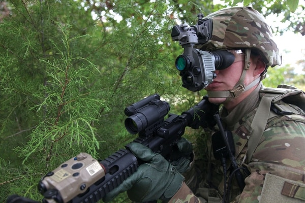 The AN/PSQ-20 Enhanced Night Vision Goggle provides dismounted warfighters the capability to observe and maneuver in all weather conditions, while enabling rapid detection and engagement with rifle-mounted aiming lasers. The next version now in development is a binocular goggle that will give a better view and integrate squad data displays for navigation and personnel locators. (Army)