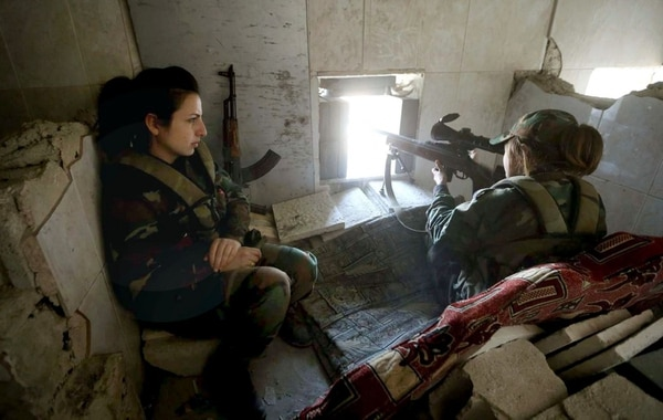 Pro-Assad regime fighters overlook a position in Syria. The fighter on the right is using an MTs-116M sniper rifle. (Syrian state media/Firearm Blog)