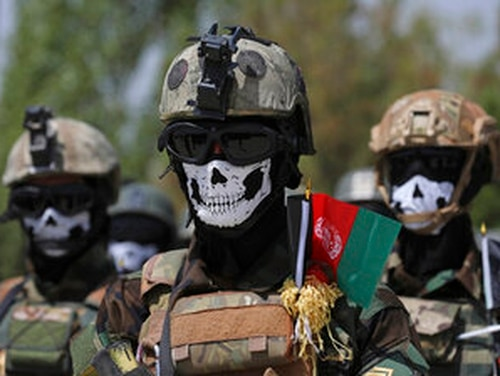 Masked Afghan Army Special Forces attend their graduation ceremony after a three-month training program at the Kabul Military Training Center. (AP Photo/Rahmat Gul, File)