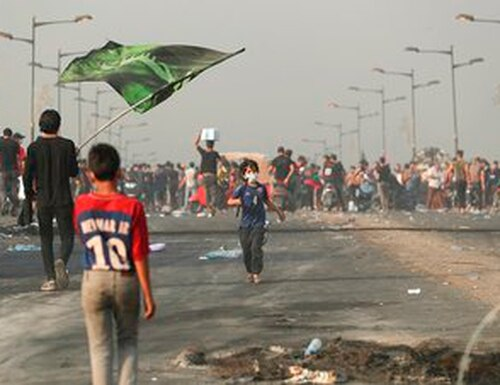Anti-government protesters gather for a demonstration in Baghdad, Iraq, Thursday, Oct. 3, 2019. Iraqi security forces fired live bullets and used tear gas against a few hundred protesters gathered in central Baghdad on Thursday, hours after a curfew was announced in the Iraqi capital on the heels of two days of deadly violence that gripped the country amid anti-government protests. (AP Photo/Hadi Mizban)