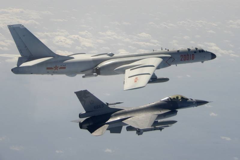 In this photo taken Feb. 10, 2020, and released by the Republic of China (ROC) Ministry of National Defense, a Taiwanese Air Force F-16 in foreground flies on the flank of a Chinese People's Liberation Army Air Force (PLAAF) H-6 bomber as it passes near Taiwan.