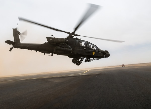 An AH-64 Apache operated by the U.S. Army's 4th Battalion, 227th Attack Reconnaissance Battalion, 42nd Combat Aviation Brigade, and Royal Saudi Land Forces personnel from 1st Battalion, 3rd Aviation Group, takes off at the start of a practice air assault during Exercise Friendship and Iron Hawk 14 on April 12, 2014, near Tabuk, Saudi Arabia.