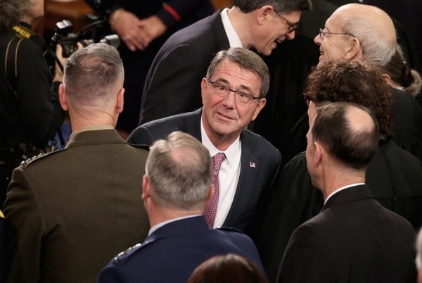 WASHINGTON, DC - JANUARY 12: U.S. Secretary of Defense Ashton Carter greets members of congress before US President Barack Obama arrives to deliver the State of the Union speech before members of Congress in the House chamber of the U.S. Capitol January 12, 2016 in Washington, DC. In his last State of the Union, President Obama reflected on the past seven years in office and spoke on topics including climate change, gun control, immigration and income inequality. (Photo by Mark Wilson/Getty Images)