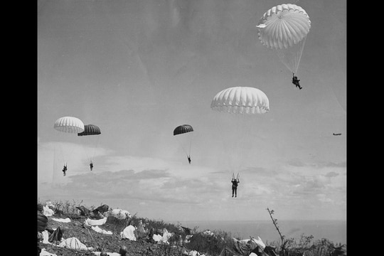 In this photo provided by the U.S. Army Signal Corps, paratroopers of the 503rd Paratroop Regiment float to the earth on the top of Corregidor as they began the American assault on