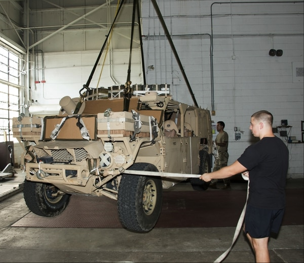 Soldiers rig the Ground Mobility Vehicle 1.1 to assess its suitability for aerial delivery with current parachute systems, rigging materials, and rigging procedures. The GMV 1.1 is designed to support special operations forces across various operations and terrains. (Army)