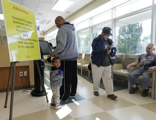 Veterans check in for appointments at the Sacramento Veterans Affairs Medical Center in Rancho Cordova, Calif., in April 2015. (Rich Pedroncelli/AP)