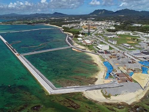 This August 2018 file aerial photo shows preliminary construction work off Henoko, in Nago city, Okinawa prefecture, Japan, where the Japanese government plans to relocate a U.S. air base from one area of Okinawa's main island to another. (Koji Harada/Kyodo News via AP)