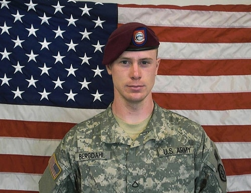 UNDATED - In this undated image provided by the U.S. Army, Sgt. Bowe Bergdahl poses in front of an American flag. U.S. officials say Bergdahl, the only American soldier held prisoner in Afghanistan, was exchanged for five Taliban commanders being held at Guantanamo Bay, Cuba, according to published reports. Bergdahl is in stable condition at a Berlin hospital, according to the reports. (Photo by U.S. Army via Getty Images)