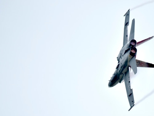 Capt. Matthew Kutryk, Royal Canadian Air Force pilot, flies a specially painted CF-18 Hornet commemorating Canada's 150th Anniversary of Confederation during the Wings Over Wayne Air Show, May 21, 2017, at Seymour Johnson Air Force Base, North Carolina. (Airman 1st Class Christopher Maldonado/U.S. Air Force)