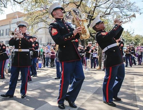 Marine Forces Reserve Band's Brass section fires up an impromptu jam session along a Mardi Gras route in New Orleans. (Marine Forces Reserve Band, Staff Sgt. William E. Baumann, III)