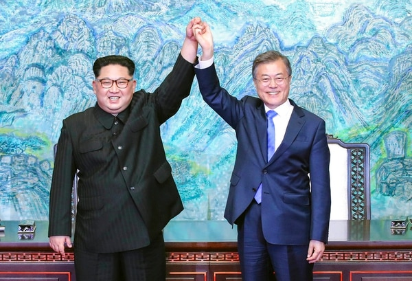 This April 27, 2018, file photo shows North Korean leader Kim Jong Un, left, and South Korean President Moon Jae-in raising their hands after signing a joint statement at the border village of Panmunjom in the Demilitarized Zone, South Korea. (Korea Summit Press Pool via AP)