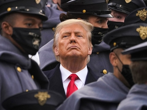 Surrounded by Army cadets, President Donald Trump watches the first half of the 121st Army-Navy Football Game in Michie Stadium at the United States Military Academy, Saturday, Dec. 12, 2020, in West Point, N.Y. (Andrew Harnik/AP)