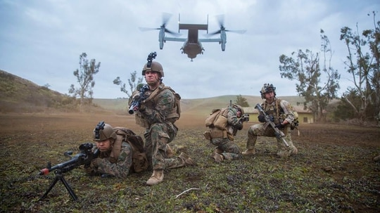 U.S. Marines with Special Purpose Marine Air-Ground Task Force-Crisis Response-Africa and a U.S. Air Force pararescueman set up a security perimeter after exiting a U.S. Marine Corps MV-22 Osprey during a full-mission profile rehearsal in Sicily, Italy, Jan. 17, 2019. (Sgt. Katelyn Hunter/Marine Corps)