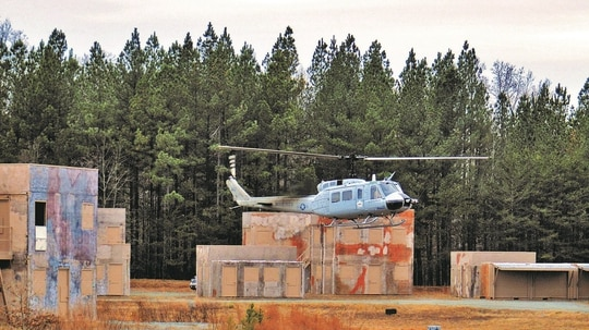 A utility helicopter lands in the middle of the Urban Training Center, Landing Zone Egret aboard the west side of Marine Corps Base Quantico using the Autonomous Ariel Cargo Utility System. (Marine Corps)