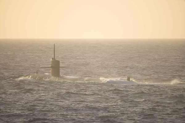 160311-N-HS305-011 WATERS NEAR GUAM (March 11, 2016) The Los Angeles-class attack submarine USS Chicago (SSN 721) sails on the surface in a multi-ship formation during Multi Sail 2016. Multi Sail 2016 is a bilateral training exercise aimed at interoperability between the U.S. and Japanese forces. This exercise builds interoperability and benefits from realistic, shared training enhancing our ability to work together. (U.S. Navy photo by Lt.j.g. Jonathan Peterson/Released)