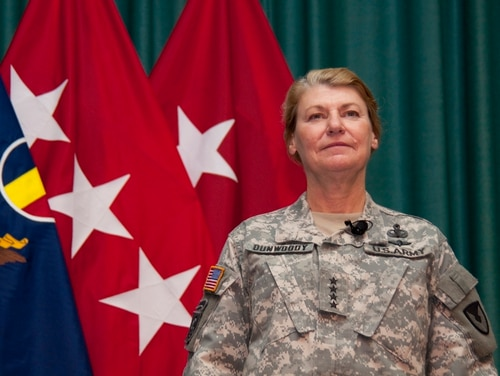 Gen. Ann E. Dunwoody, commanding general of U.S. Army Materiel Command, stands as she is introduced during the Women's History Month Observance on Fort Monroe, Va., March 29, 2010. TRADOC and 633d Air Base Wing hosted the Women's History Month Observance with guest panelists Dunwoody, Honorable Thelma Drake, Susan Kilrain, and Cmd. Sgt. Maj. Teresa King. (U.S. Army photo by Sgt. Angelica Golindano) (RELEASED)