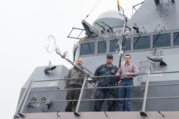 Members of the Naval Postgraduate School's Directed Energy Research Group measure turbulence while on board the guided-missile destroyer Spruance off the coast of San Diego last summer. They collected data to help estimate the performance of high-energy lasers at sea. (Mass Communication Specialist 1st Class Ryan D. McLearnon/Navy)