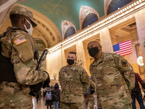 National Guard troops assigned to Joint Task Force Empire Shield discuss operations at Grand Central Station in New York City on Dec. 11, 2020. (Staff Sgt. Jonathan Pietrantoni/Air National Guard)