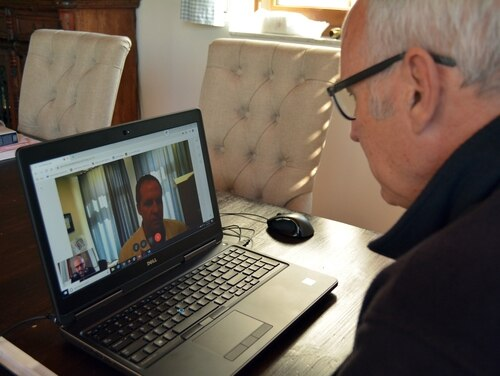 A public affairs specialist with Regional Health Command Europe, demonstrates a virtual health at-home visit with Lt. Col. (Dr.) Brent Feldt, an otolaryngologist at Landstuhl Regional Medical Center.