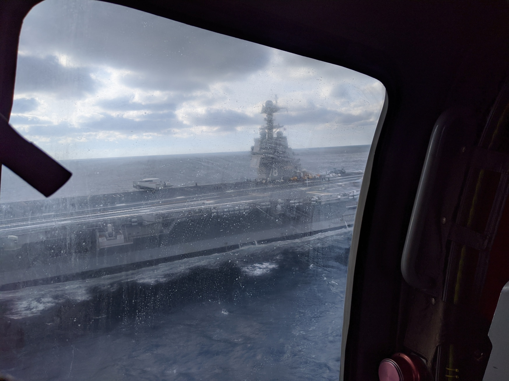 The carrier Gerald R. Ford as seen from the door of an MH-60R Seahawk helicopter. (David B. Larter/Staff)