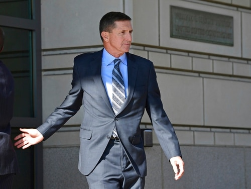In this Dec. 1, 2017, file photo, former Trump national security adviser Michael Flynn leaves federal court in Washington. (Susan Walsh/AP)