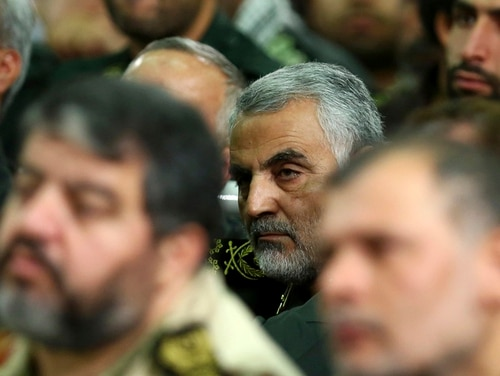 In this Tuesday, Sept. 17, 2013 photo released by an official website of the office of the Iranian supreme leader, then chief of the Quds Force of Iran's Revolutionary Guard, Ghasem Soleimani, attends a meeting of the commanders of the Revolutionary Guard with Supreme Leader Ayatollah Ali Khamenei in Tehran, Iran. Gen. Soleimani, a powerful Iranian general, has emerged as the chief tactician in Iraq's fight against Sunni militants, working on the front lines alongside 120 advisers from his country's Revolutionary Guard to direct Shiite militiamen and government forces in the smallest details of battle, militia commanders and government officials say. (AP Photo/Office of the Iranian Supreme Leader)