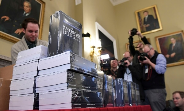 Gary Haglund, left, helps to unpack copies of the President's FY19 Budget after it arrived at the House Budget Committee office on Capitol Hill on Feb. 12, 2018. The plan includes a nearly 7 percent increase in VA spending next year. (Susan Walsh/AP)