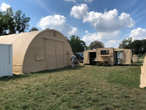 The dining facility, on left, with the camp's kitchen on right. During the DABS exercise, U.S. Air Force personnel ate breakfast and dinner with Polish forces, while airmen from the 200th RED HORSE Squadron DET 1, Ohio Air National Guard, cooked daily lunches. (Valerie Insinna/Staff)