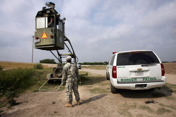 A member of the National Guard checks on his colleague inside a Border Patrol Skybox near the Hidalgo International Bridge in Texas in April 2011. White House officials on Wednesday said they hope to conduct similar National Guard border security support missions in coming weeks. (Delcia Lopez/AP)