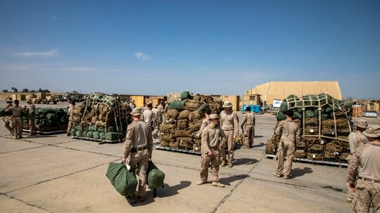 U.S. Marines with 2nd Battalion, 7th Marines, assigned to Special Purpose Marine Air-Ground Task Force – Crisis Response – Central Command prepare their gear for departure in support of the transfer of Al-Taqaddum, Iraq, Mar. 24, 2020. (Sgt. Robert G. Gavaldon/ Marine Corps)