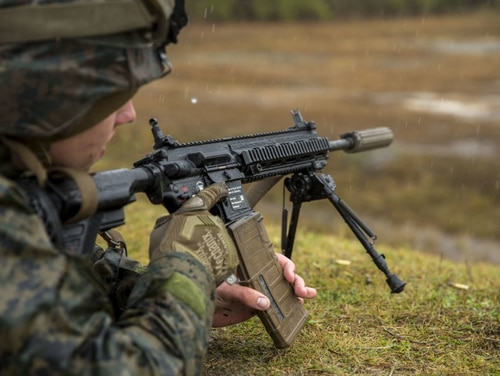 U.S. Marines with 3rd Battalion 8th Marine Regiment fire the M27 Infantry Automatic Rifle during a live-fire weapons exercise at range F-18 on Camp Lejeune, North Carolina, Dec. 8, 2017. (Lance Cpl. Michaela R. Gregory/ Marine Corps)