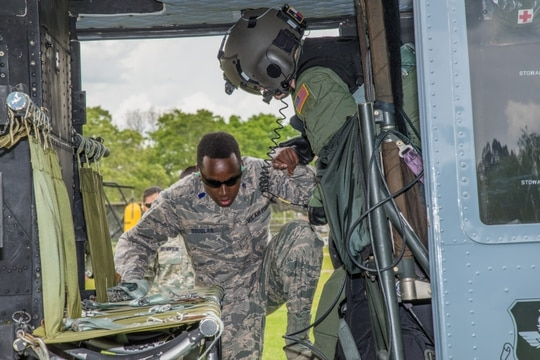 Cadet Torey Douglas, an AFROTC student at Tuskegee University in Alabama, boards a UH-TH1 Huey. The Air Force is increasing the number of scholarships for students to attend ROTC at historically Black colleges and universities like Tuskegee, and adding more Gold Bar recruiters for schools that primarily serve Black and Hispanic students. (Stanley Ward/Air Force)