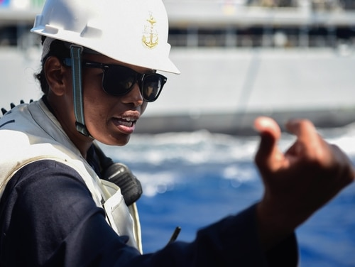 Senior Chief Boatswain's Mate Mumira Ferah gives instructions aboard USS Ross during a replenishment at-sea. As many as 1,100 senior enlisted sailors could find themselves in a fleet or operational billet in the coming months as part of the Navy's efforts to increase fleet supervisor manning (Navy).