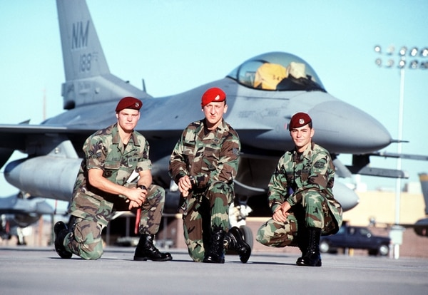 Senior Airman Ron Ellis (from left), Staff Sgt. Andy Kubik, a combat controller, and Staff Sgt. Jeremy Hardy, a pararescueman, members of a rescue team, pose in front of an F-16 Fighting Falcon aircraft at Hurlburt Field, Florida. This image is from the February 2000 Airman Magazine article