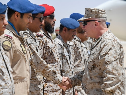 Marine Corps Gen. Kenneth F. McKenzie Jr., the commander of U.S. Central Command, right, shakes hands with airmen of the Royal Saudi Air Force on Prince Sultan Air Base, July 18, 2019. (Sgt. Roderick Jacquote/Marine Corps)