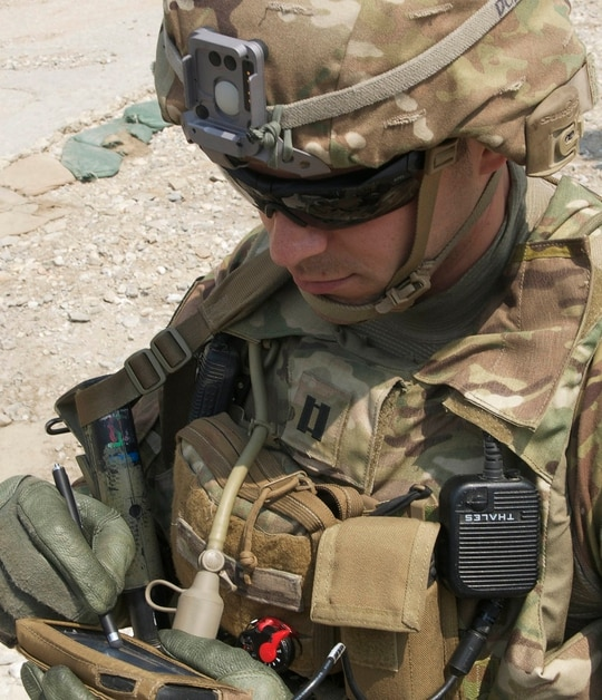 Capt. Jonathan Page tests a mobile device during training at Fort Polk, La. (Sgt. 1st Class E. L. Craig/Army)