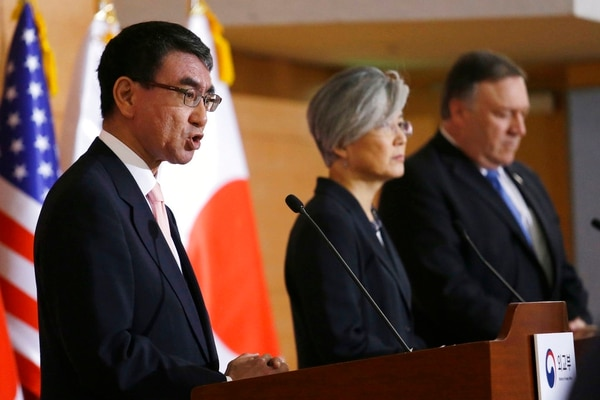 Japanese Foreign Minister Taro Kono, left, speaks as U.S. Secretary of State Mike Pompeo, right, and South Korean Foreign Minister Kang Kyung-wha listen during a joint press conference following their meeting at Foreign Ministry in Seoul, South Korea, Thursday, June 14, 2018. (Ahn Young-joon/AP)